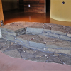Sandstone indoor stairs and hearth