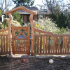 Hand split cedar fencing with gate and arbour