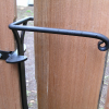 Sprung gate latch with one way catch