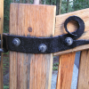 Curved gate hinge