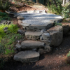 Greenhouse pad with drystack stone steps/walls